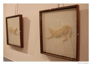 "From the series ""Fleeced"", Tully uses cotton waste and thread on Fabriano to express the unfeeling  victimization of animals in the mass production of animal products and byproducts by the humankind."